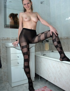 Sexy in pantyhose takes shower